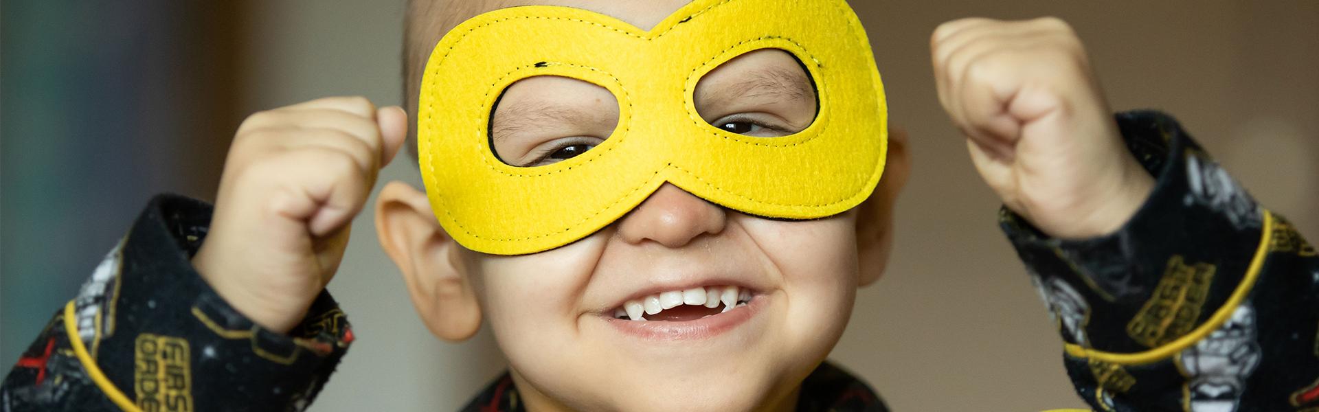 Little boy with superhero mask